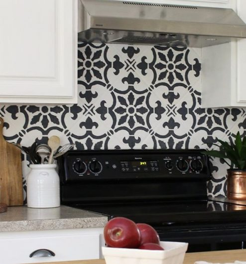 A DIY stenciled kitchen backsplash using the Fabiola Tile Stencil from Cutting Edge Stencils. http://www.cuttingedgestencils.com/fabiola-tile-stencil-spanish-portugese-tiles-stencils.html