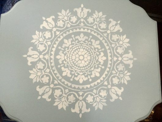 A blue and white DIY stenciled table makeover using the Gratitude Mandala Stencil from Cutting Edge Stencils. http://www.cuttingedgestencils.com/gratitude-mandala-stencil-yoga-designs.html