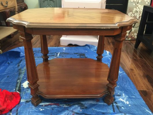 A wooden two tiered table before its stenciled makeover. http://www.cuttingedgestencils.com/gratitude-mandala-stencil-yoga-designs.html