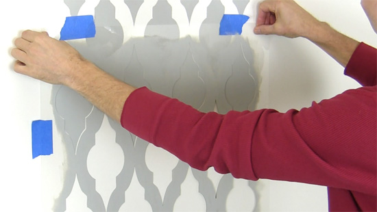 Learn how to stencil a DIY gray and white Moroccan stenciled accent wall using the Taj Mahal Allover Stencil from Cutting Edge Stencils. http://www.cuttingedgestencils.com/taj-mahal-wall-pattern-stencil.html