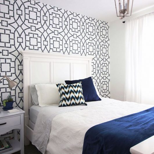 A guest bedroom with a white and charcoal gray stenciled accent wall using the Tea House Trellis Allover Stencil from Cutting Edge Stencils. http://www.cuttingedgestencils.com/tea-house-trellis-allover-stencil-pattern.html