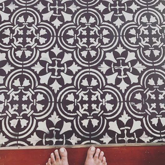 A black and white DIY stenciled floor using the Augusta Tile Stencil from Cutting Edge Stencils. http://www.cuttingedgestencils.com/augusta-tile-stencil-design-patchwork-tiles-stencils.html
