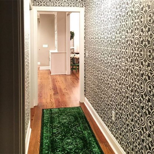 A stenciled hallway with a wallpaper look using the Augusta Tile Stencil from Cutting Edge Stencils. http://www.cuttingedgestencils.com/augusta-tile-stencil-design-patchwork-tiles-stencils.html