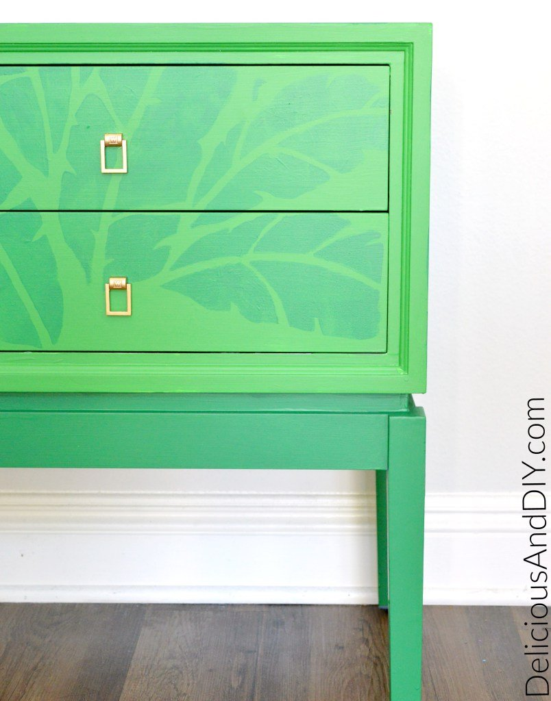 A DIY stenciled green side table using the Banana Leaf Allover Stencil from Cutting Edge Stencils. http://www.cuttingedgestencils.com/banana-leaf-stencil-tropical-wallpaper-palm-leaves-print.html