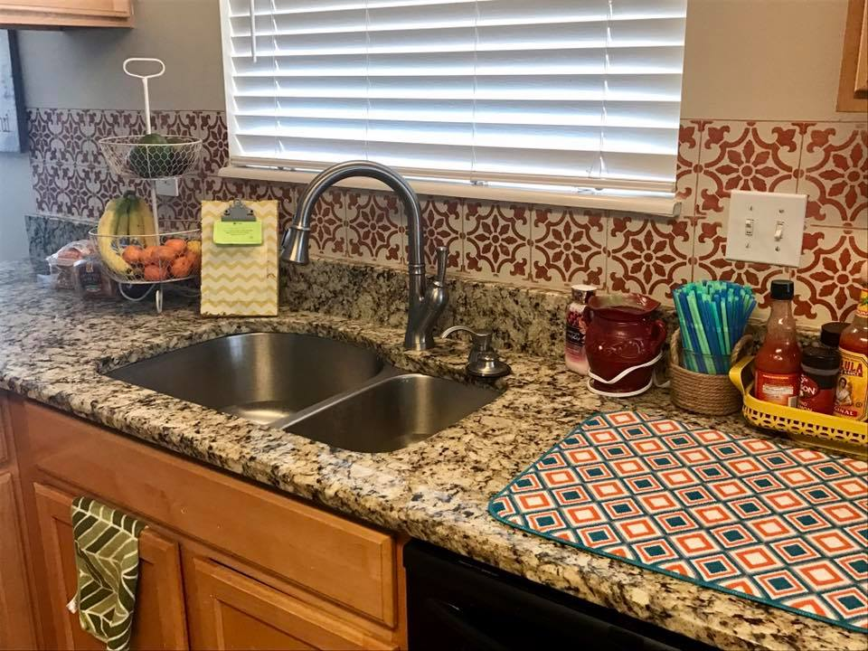 A DIY metallic copper stenciled kitchen backsplash using the Fabiola Tile Stencil from Cutting Edge Stencils. http://www.cuttingedgestencils.com/fabiola-tile-stencil-spanish-portugese-tiles-stencils.html