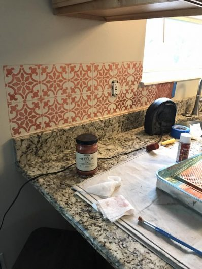 Stenciling a kitchen backsplash in metallic copper using the Fabiola Tile Stencil from Cutting Edge Stencils. http://www.cuttingedgestencils.com/fabiola-tile-stencil-spanish-portugese-tiles-stencils.html
