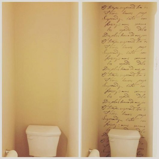 A creamy colored stenciled bathroom accent wall using the French Poem Allover Stencil from Cutting Edge Stencils. http://www.cuttingedgestencils.com/french-typography-letter-wall-stencil.html