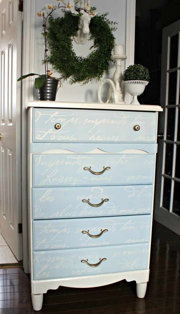 A DIY blue and white stenciled dresser using the French Poem Allover Stencil from Cutting Edge Stencils. http://www.cuttingedgestencils.com/french-typography-letter-wall-stencil.html