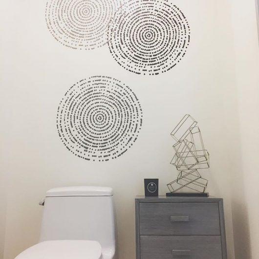 A DIY stenciled bathroom with a hint of pattern using the Resonance Wall Art Stencil from Cutting Edge Stencils. http://www.cuttingedgestencils.com/resonance-modern-wall-art-stencil.html