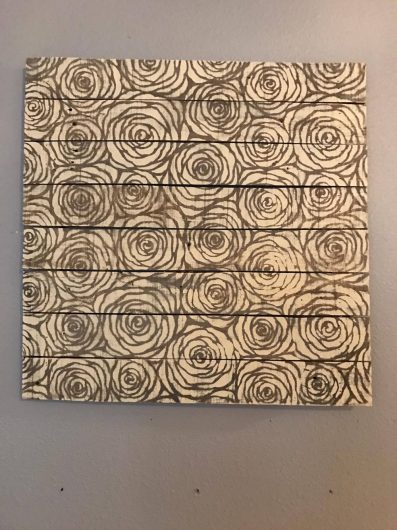 A DIY stenciled driftwood wall art project using the Roses Allover Stencil from Cutting Edge Stencils. http://www.cuttingedgestencils.com/roses-stencil-pattern-rose-design.html