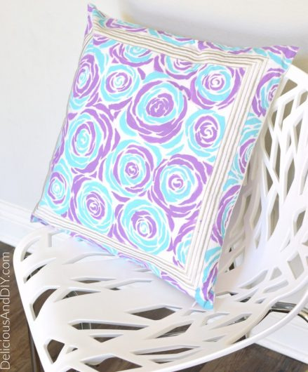 A DIY stenciled pillow cushion using the Roses Allover Stencil from Cutting Edge Stencils. Project via Delicious and DIY http://www.cuttingedgestencils.com/roses-stencil-pattern-rose-design.html