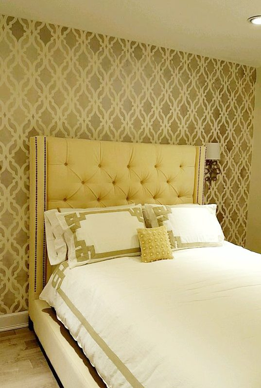 A golden yellow DIY stenciled bedroom accent wall using the Tamara Trellis Allover Stencil from Cutting Edge Stencils. http://www.cuttingedgestencils.com/tamara-trellis-allover-wall-stencils.html