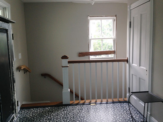 A guest bedroom with a stenciled plywood floor using the Augusta Tile Stencil from Cutting Edge Stencils. http://www.cuttingedgestencils.com/augusta-tile-stencil-design-patchwork-tiles-stencils.html