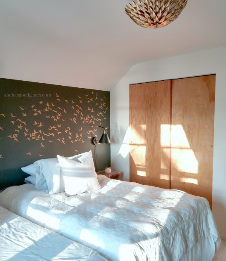 A DIY stenciled bedroom accent wall in dark gray and metallic gold using the Flock of Cranes from Cutting Edge Stencils. http://www.cuttingedgestencils.com/bird-flock-wall-stencil-pattern.html