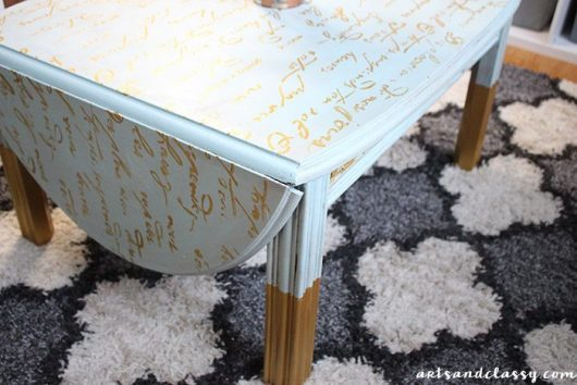 A DIY stenciled wooden coffee table using the French Poem Craft Stencil from Cutting Edge Stencils. http://www.cuttingedgestencils.com/french-poem-diy-craft-stencil-design.html