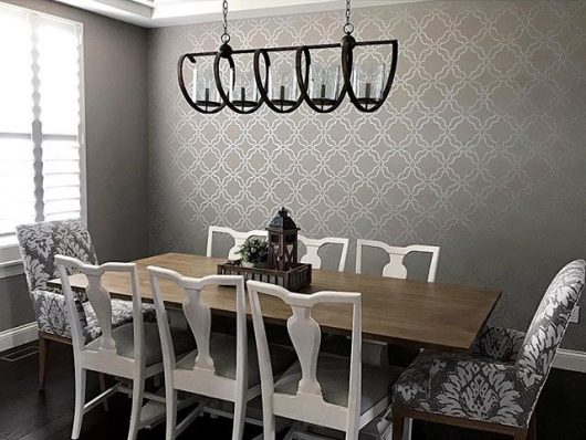 A DIY stenciled dining room metallic silver accent wall using the Sarrah Trellis Allover Stencil from Cutting Edge Stencils. http://www.cuttingedgestencils.com/sarah-trellis-stencil-moroccan-stencils-wall-pattern-design.html
