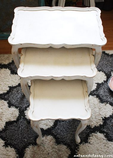 A set of white nesting tables before their stenciled makeover. http://www.cuttingedgestencils.com/peacock-feathers-stencil-for-pillow-kit.html