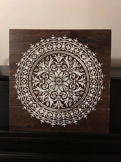 Recycled wooden wall art using the Abundance Mandala Stencil from Cutting Edge Stencils. http://www.cuttingedgestencils.com/abundance-mandala-stencil-yoga-wall-stencils-mandalas.html