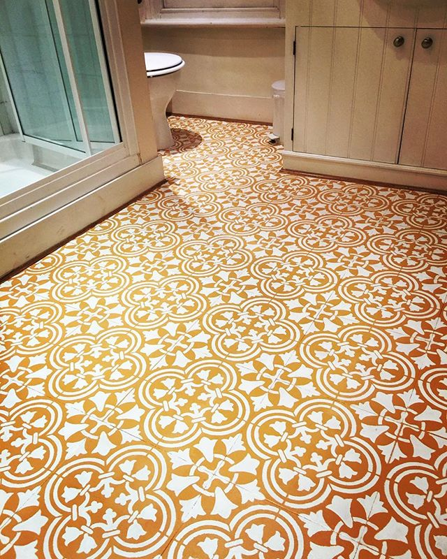 Stencils give an old vinyl floor a budget friendly new for Paint over vinyl floors