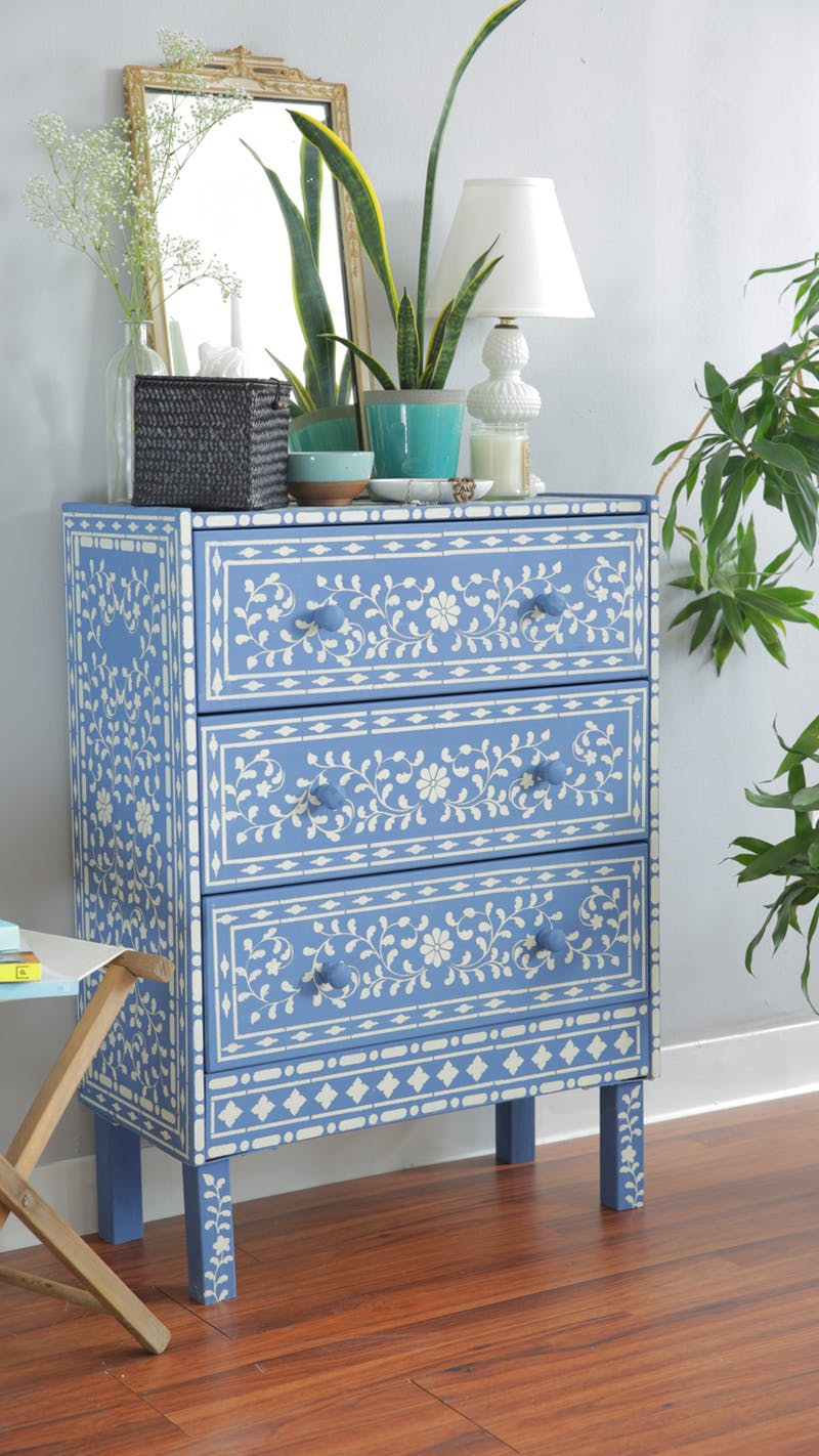 A DIY stenciled $35 Ikea Rast pine dresser that was painted and stenciled using the Indian Inlay Stencil Kit designed by Kim Myles from Cutting Edge Stencils. Project via Apartment Therapy. http://www.cuttingedgestencils.com/indian-inlay-stencil-furniture.html