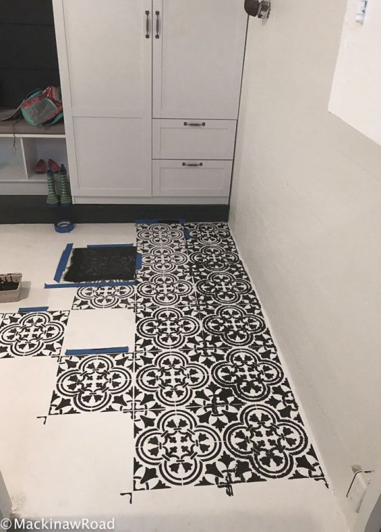 Stenciling a concrete basement floor using the Augusta Tile Stencil from Cutting Edge Stencils. http://www.cuttingedgestencils.com/augusta-tile-stencil-design-patchwork-tiles-stencils.html