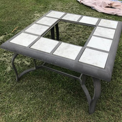 An old firepit before its stenciled makeover. http://www.cuttingedgestencils.com/augusta-tile-stencil-design-patchwork-tiles-stencils.html