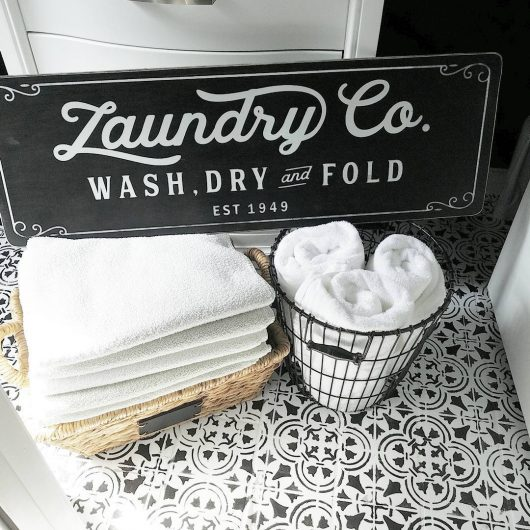 A black and white DIY stenciled and painted laundry room floor using the Augusta Tile Stencil from Cutting Edge Stencils. http://www.cuttingedgestencils.com/augusta-tile-stencil-design-patchwork-tiles-stencils.html