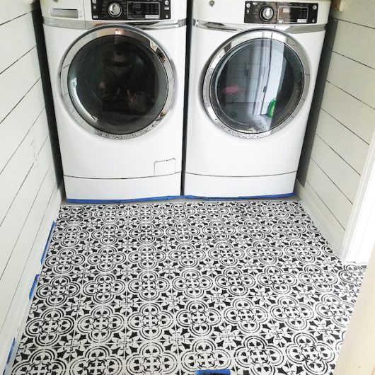 Stenciling a laundry room floor using the Augusta Tile Stencil from Cutting Edge Stencils. http://www.cuttingedgestencils.com/augusta-tile-stencil-design-patchwork-tiles-stencils.html