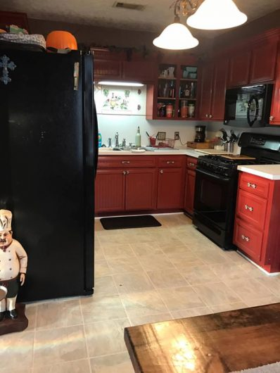 A kitchen backsplash before its stenciled makeover. http://www.cuttingedgestencils.com/santa-ana-tile-stencil-spanish-tiles-cement-tile-patterns.html
