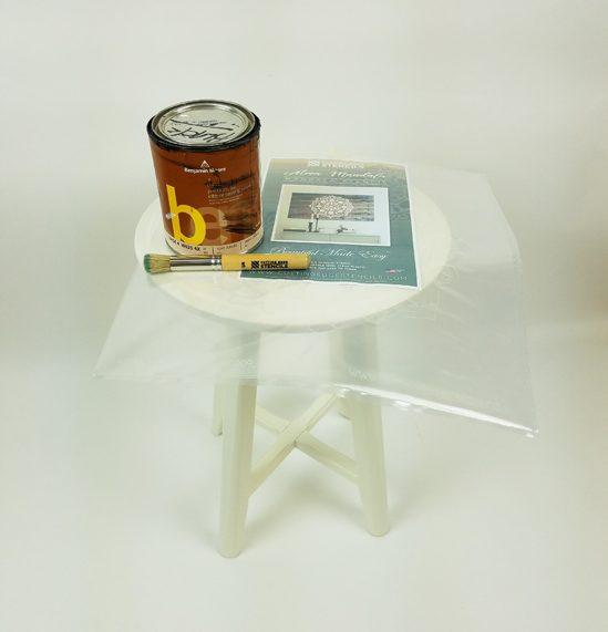An plain white Ikea side table before its stenciled makeover. http://www.cuttingedgestencils.com/stencil-mandala-atma-medallion-deisgn-stencils.html
