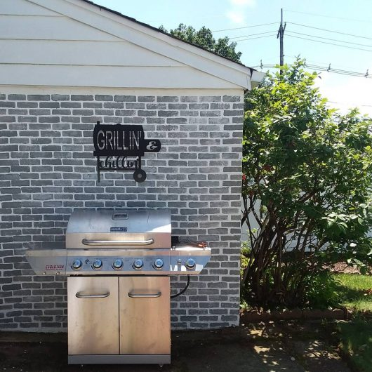 A DIY stenciled cement wall with the Brick Wall Stencil pattern from Cutting Edge Stencils. http://www.cuttingedgestencils.com/bricks-stencil-allover-pattern-stencils.html