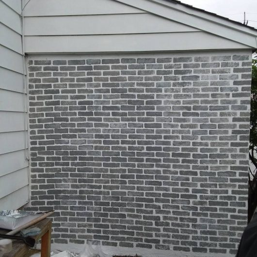 Stenciling a cement wall with the Brick Wall Stencil pattern from Cutting Edge Stencils. http://www.cuttingedgestencils.com/bricks-stencil-allover-pattern-stencils.html