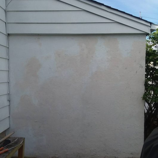 A cement wall before its faux brick stencil makeover.. http://www.cuttingedgestencils.com/bricks-stencil-allover-pattern-stencils.html