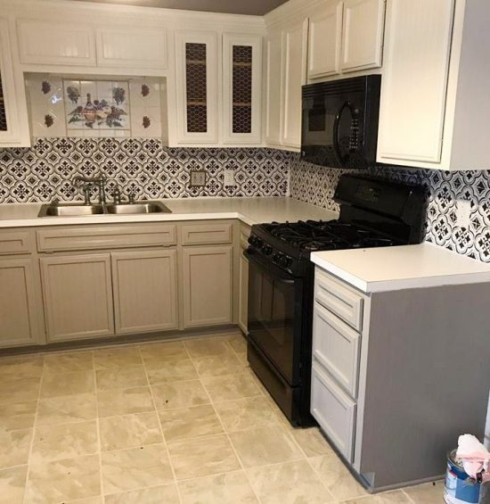 A DIY stenciled faux tile backsplash in a kitchen using the Santa Ana Tile Stencil from Cutting Edge Stencils. http://www.cuttingedgestencils.com/santa-ana-tile-stencil-spanish-tiles-cement-tile-patterns.html