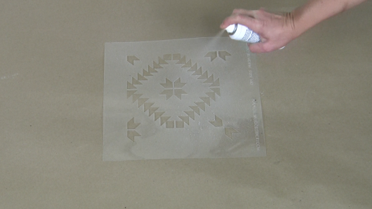 Use spray adhesive to help hold the stencil in place. http://www.cuttingedgestencils.com/geometric-tile-stencil-painted-backsplash-stencils-cement-tile.html