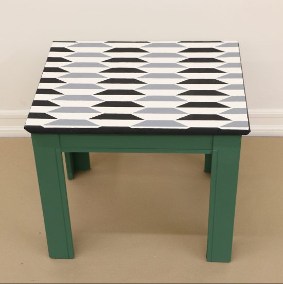 Learn how to stencil and paint an old wooden side table using the Prism Geometric Stencil from Cutting Edge Stencils. http://www.cuttingedgestencils.com/prism-stencil-geometric-wall-pattern.html