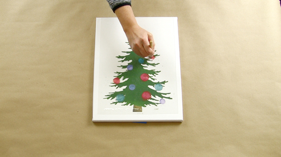 Learn how to make DIY light up Christmas Tree artwork using a craft stencil from Cutting Edge Stencils. http://www.cuttingedgestencils.com/christmas-tree-stencil.html