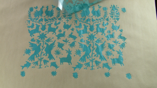 Cutting Edge Stencils shares how to make custom gift wrapping paper using the Otomi Craft Stencil and brown kraft paper. http://www.cuttingedgestencils.com/otomi-pattern-craft-stencil-DIY-home-decor-project.html