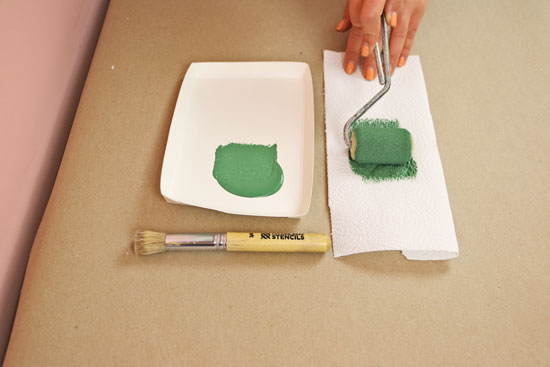 Rolling on green paint to stencil brush