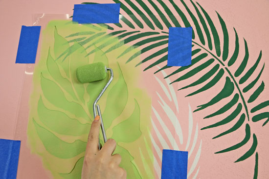 painting the tropical all using palm fronds stencil