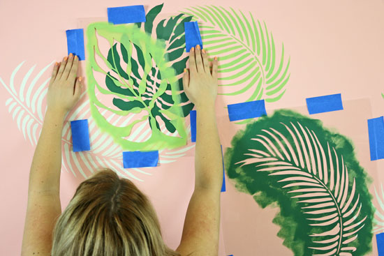 Overlapping palm fronds stencil to create tropical wall design
