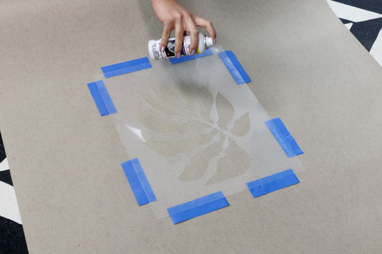 Spray adhesive to back of the stencil