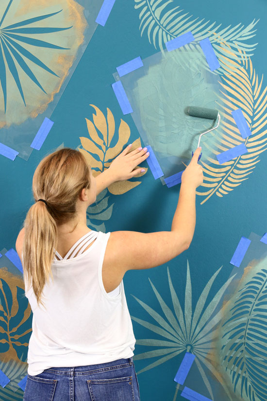 Begin overlapping stencils for desired wall mural look