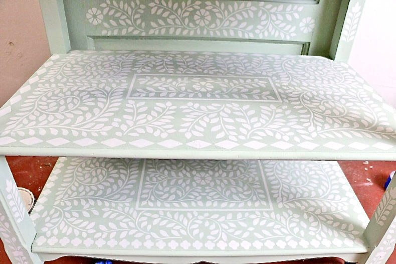 stenciled potting bench shelves