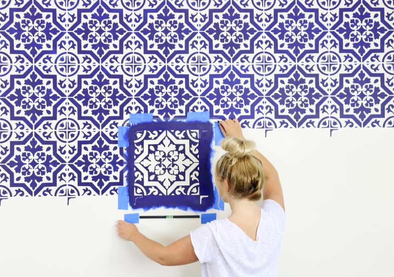 placing tile stencil on wall