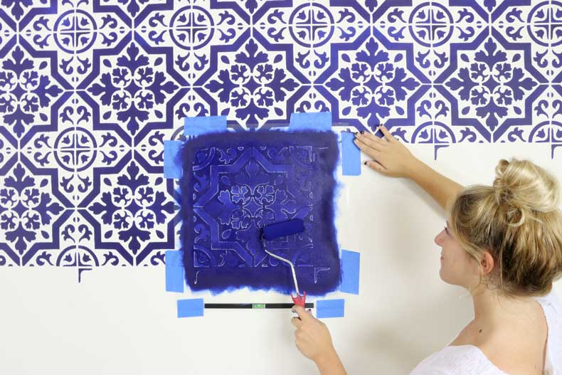 rolling paint navy tile stenciled accent wall