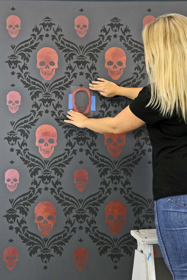 stenciled halloween skull feature wall place mini skull