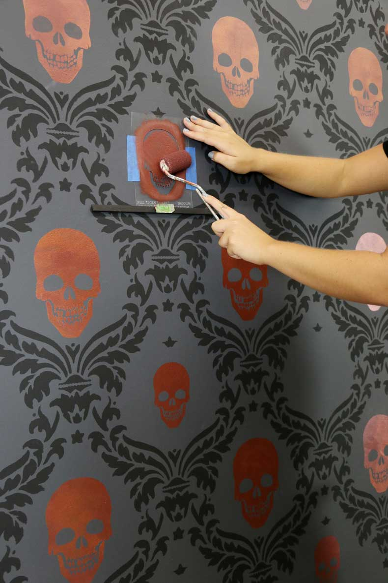 stenciled halloween skull feature wall blend colors