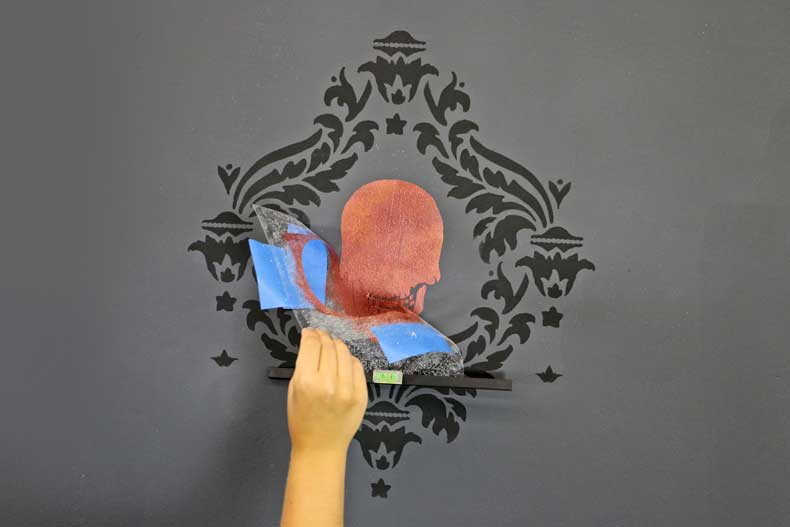 stenciled halloween skull feature wall peel skull
