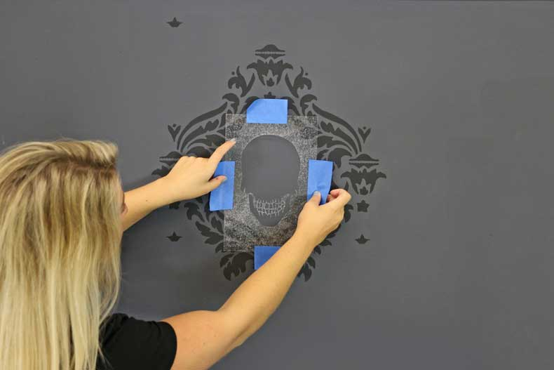stenciled halloween skull feature wall place skull